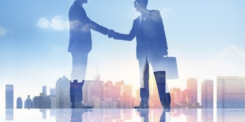 Silhouettes of Two Businessmen Having Handshake
